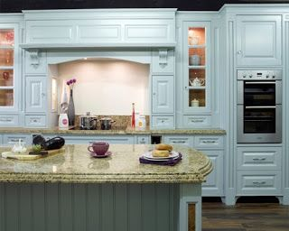 Duck egg blue kitchen with marble bench top and range