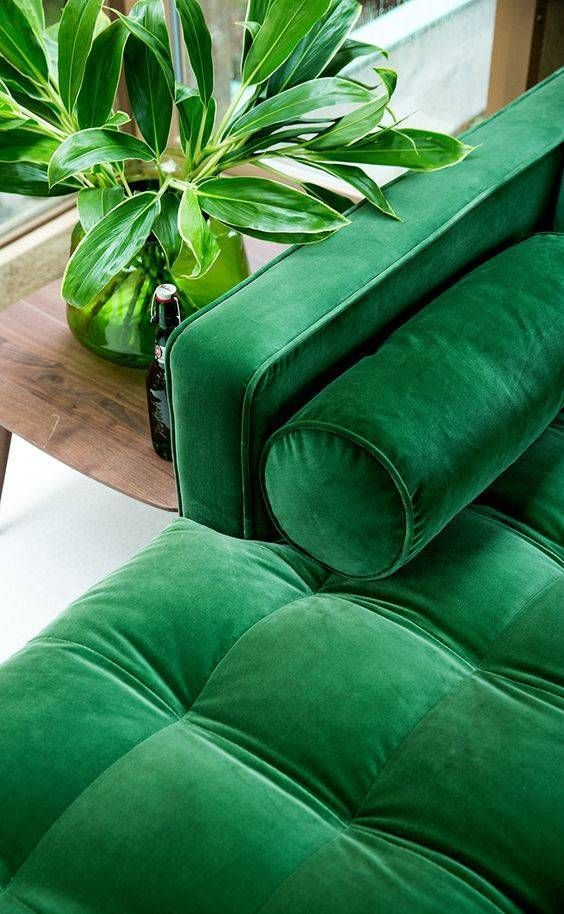 Pantone 2017 colour this deep green in velvet its simply awesome.  Loved the modern lines from the sofa as well.