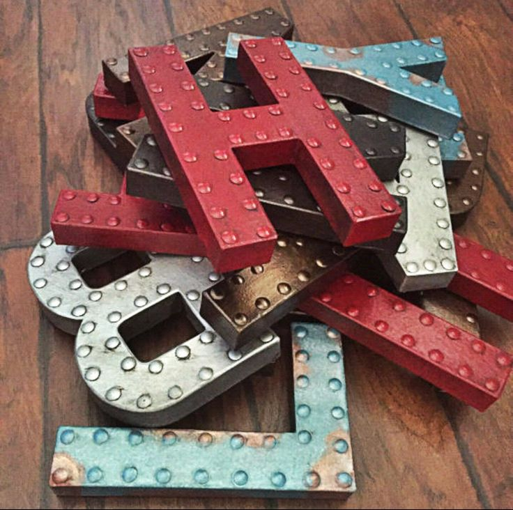 Cardboard letters with glues tick dots and spray painted metallic                                                                                                                                                     More