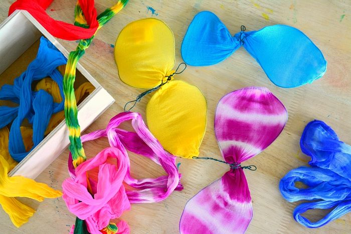 Butterflies made with stocking pieces at How we Montessori