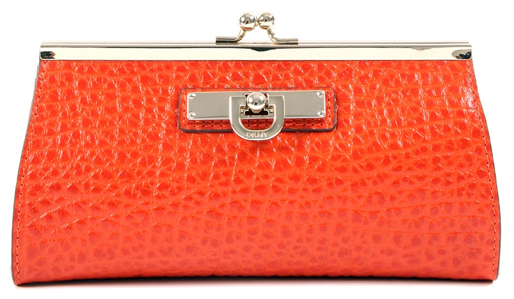 A polished look and a classy design make this orange shade clutch from DKNY