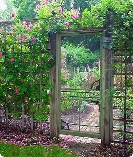 So, you could have a great fence that outlines the perimeter of your home or garden and offer accessibility with a simple swinging gate. Or you could take it one step further and add a cool garden door like this. The simple wooden frame holds a screen so the door doesn't obstruct anything, just adds to the beauty of your home.