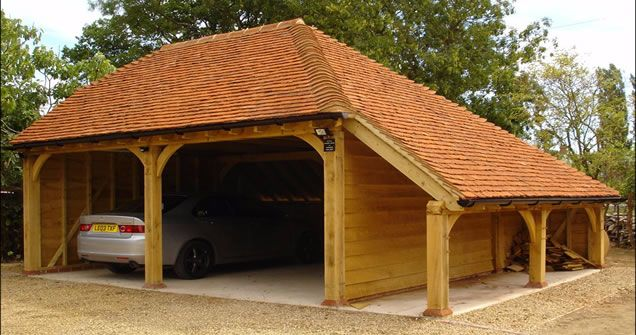 Red tiled oak car port with log store