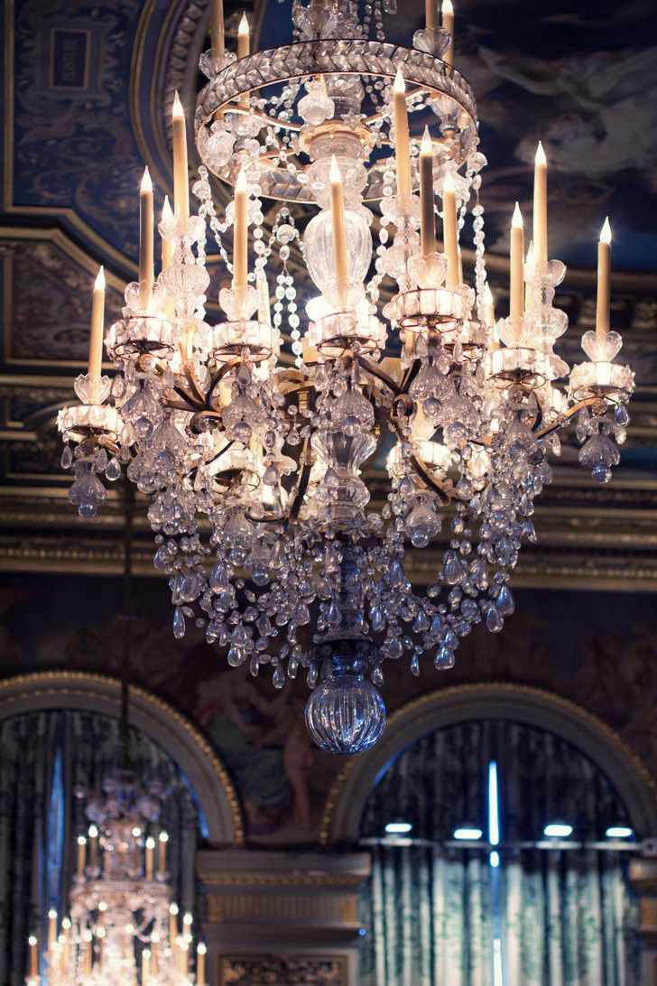 I love how this chandelier melts into a magnificent collection of crystal prisms, garlands, scrolls, and chains.  Business above; party below!