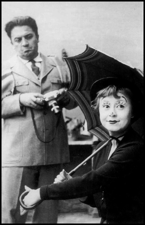 Federico Fellini and wife, Giulietta Masina on set: La Strada (1954). She starred in almost all his films, and they were partners. I never knew this. :-0 Often the deal in creative marriages. If one is not creative... the other would be bored.