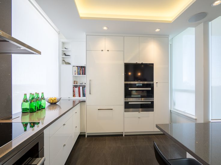 Panel ready appliances create a cohesive look in this modern kitchen.