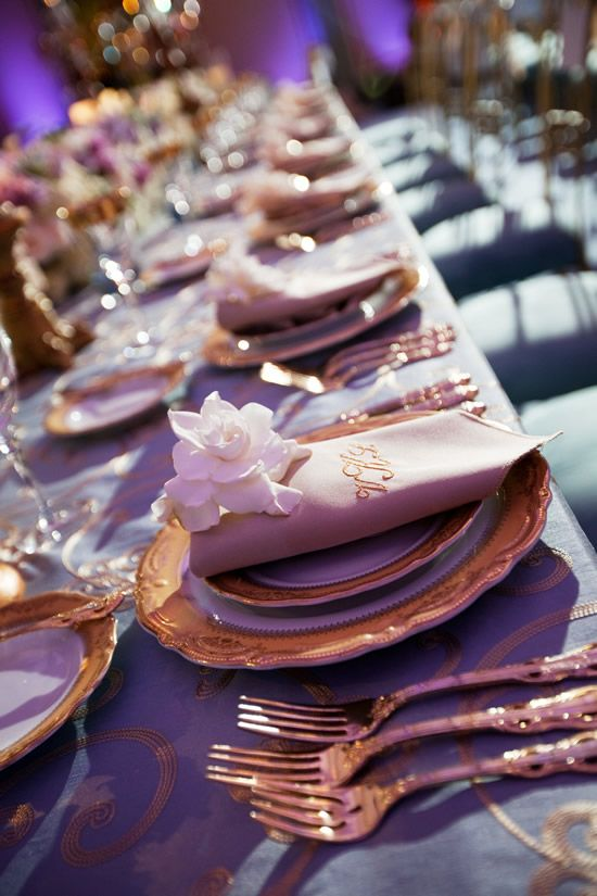 Fine gold-rimmed china with monogrammed embroidered napkins