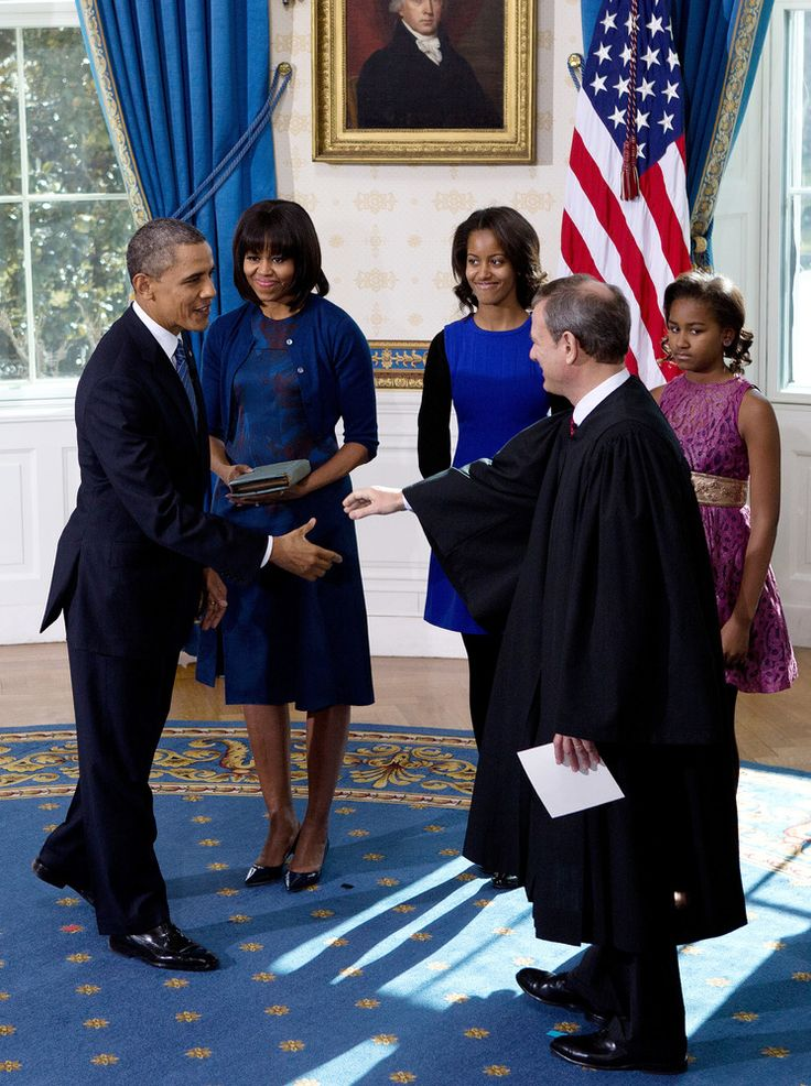 WASHINGTON - JANUARY 20: U.S President Barack Obama (L) shakes hands U.S. Supreme Court Chief Justice John Roberts (2nd R) after takes the oath of office as first lady Michelle Obama (2nd L), daughter Malia (C) and Sasha (R) looks on in the Blue Room of the White House January 20, 2013 in Washington, DC. Obama and U.S. Vice President Joe Biden were officially sworn in a day before the ceremonial inaugural swearing-in.