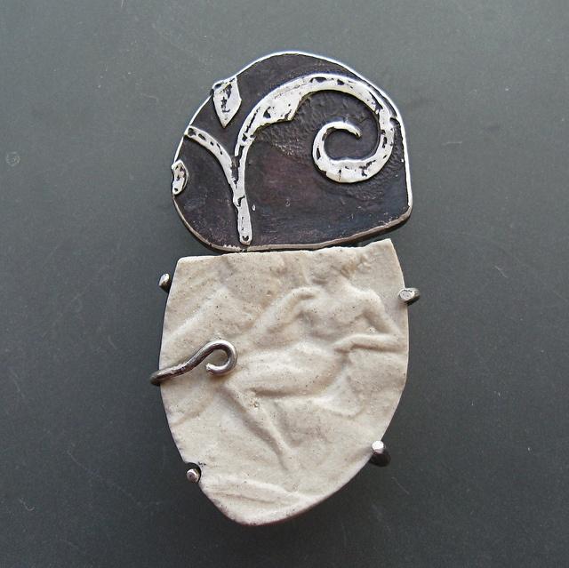 Lora Hart - fragment series, brooch #2 - .999 Silver clay, sterling, steel, porcelain.  Kiln Fired, soldered, set.