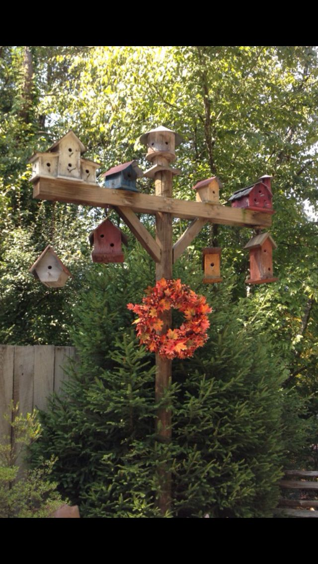 Birdhouses. Love this idea for the back corner of the yard.
