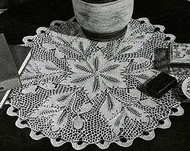 Frosted Ferns Doily knit pattern originally published in Doilies, Spool Cotton Book 201.  #doilypatterns