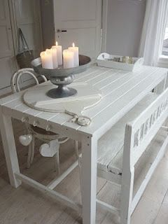 My sound weird but I love everything about this pic! The table, the benches, the centerpiece with romantic candles and the soft white curtains....aaaahhhh...
