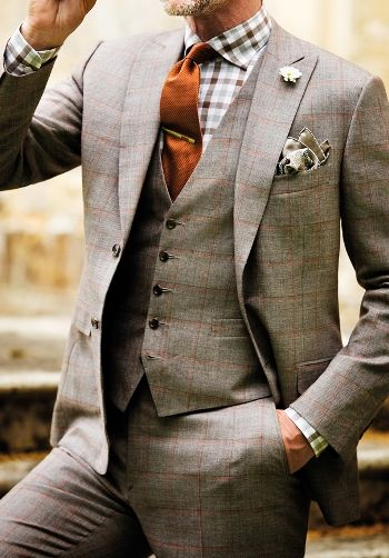 Plaid suit and vest + checkered button down + orange tie