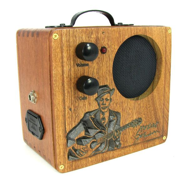 Cigar Box Amplifier: All-Wood Custom-carved Robert Johnson No. 1. The heart is an Artec SDA-T 2.5W amp board, which is powered by a 9V battery. The amp accepts a standard 1/4 mono guitar/amp cord as input, and output is through a 3.5 1W speaker.