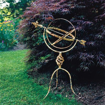 Get the look of a vintage garden ornament without the price. Buy a new piece and weather it yourself by lightly sanding the surface and appl...
