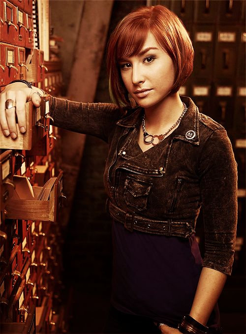 Claudia from Warehouse 13. She is smart and spunky, two traits I strive for.