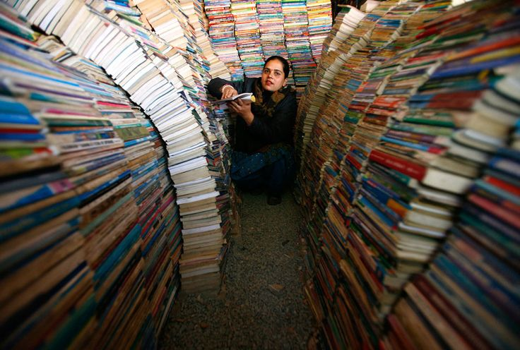 Ishwori Sapkota, as she arranges books at her book store in Kathmandu, on December 18, 2011. She has been selling and buying second hand books for the past eighteen years. (Reuters/Navesh Chitrakar)