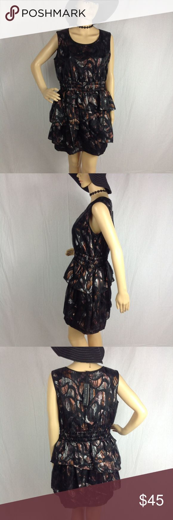 NWT Doro Landa Metallic Mini Dress Size 12 Layered This dress is black, burnt orange, and silver. The waist is gathered and stretches. See all pictures! As always offers and bundles are welcome. Feel free to add one or more items to a bundle for a private discount offer!!! Armpit to armpit is 19.25 inches across Waist is 15.75 inches across Hips are 20 inches across Length is 32.75 inches Doro Landa Dresses Mini