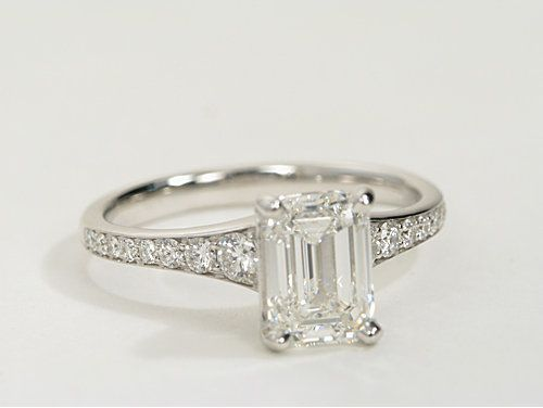 Simple graduated band set with brilliant diamond beautifully sets off the emerald cut centre diamond