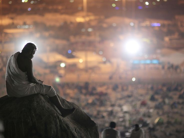 A Muslim pilgrim prays on a rocky hill called the Mountain of Mercy on the Plain of Arafat near the holy city of Mecca, Saudi Arabia, during the hajj pilgrimage. Mount Arafat, marked by a white pillar, is where Islam's Prophet Mohammed is believed to have delivered his last sermon to tens of thousands of followers some 1,400 years ago, calling on Muslims to unite.  Mosa'ab Elshamy, AP