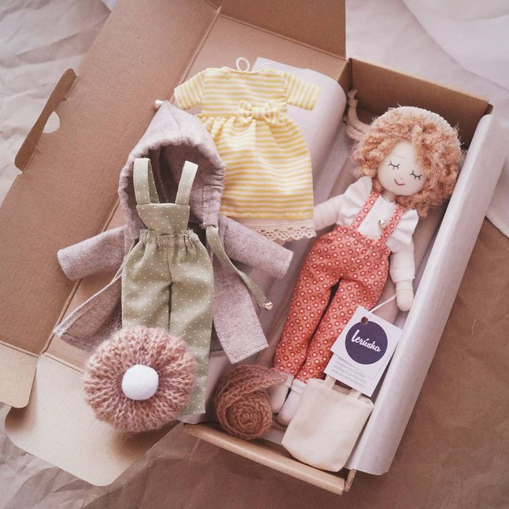 doll and clothes in gift box