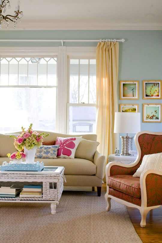 love the wall color, curtains and colorful pillows