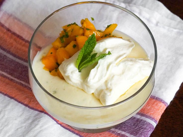 Lime Possets With Mint and Mango Fruit Salad | Usually eggs, gelatin, or starch is called for to thicken a pudding; possets, however, are thickened with nothing but citrus juice. Using lime juice gives your possets a tropical brightness that pairs perfectly with a simple fruit salad of mango and mint.	  #desserts #dessertrecipes #sweettooth #seriouseats #recipes #fruitsalad #fruitdesserts