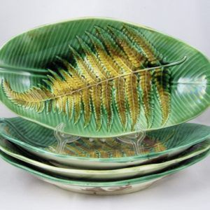 An unusual and rarely seen set of four Wedgwood majolica deep trays. Gorgeous mold work – the leaf shaped pieces are glazed in varying shades of green and show a mustard yellow glazed fern fr…
