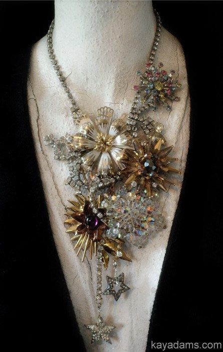 This could be a runway necklace for sure. Love the rhinestones with the floral and spike shaped brooches. A bold piece but so pretty.
