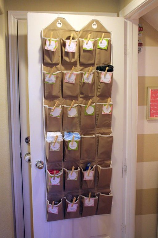 """Over the door organizer used to hold those """"hard to place"""" items.  Note the clothespins used to attach the labels so they are super easy to change.  From A Thoughtful Place posted on iheartorganizing"""