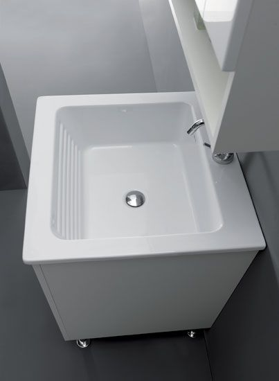 Unit made in V100 18 mm water-repellent laminate faced particleboard, two-panel opening, with slow-motion closing system. Protection bottom panel in aluminium, copper and nickel plated metal hinges with triple mechanism tested for 100 thousand openings/closings, synthetic bracket for wall mounting. Ceramic washbasin with Integrated Laundry System (SIL®), the centre of the washbasin is prepared for a single-lever mixer, integrated overflow. Available in two finishes