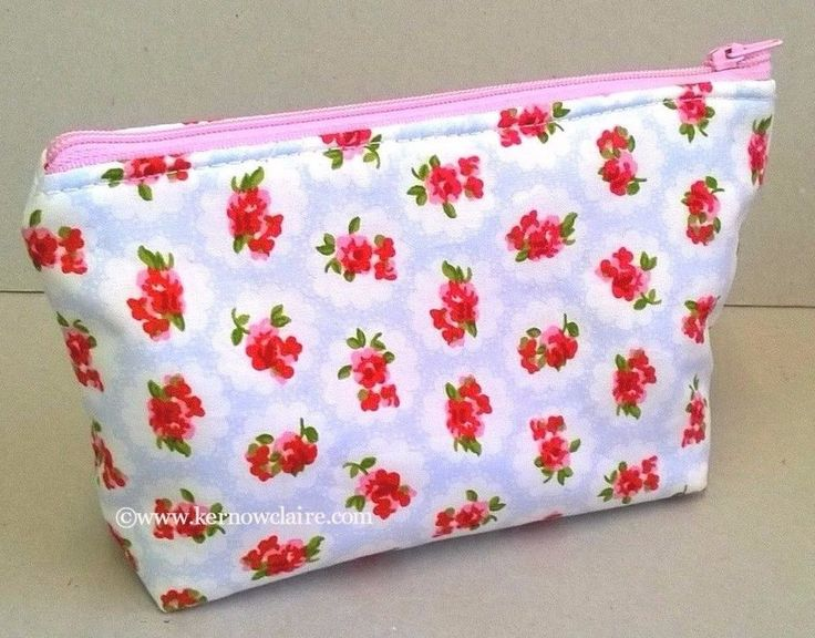 Handmade in a pale blue cotton fabric with small pink flowers. Lined in pale pink and white stripes. This is a lovely make up bag for ladies. Perfect for cosmetic storage. This item can be gently hand washed. | eBay!