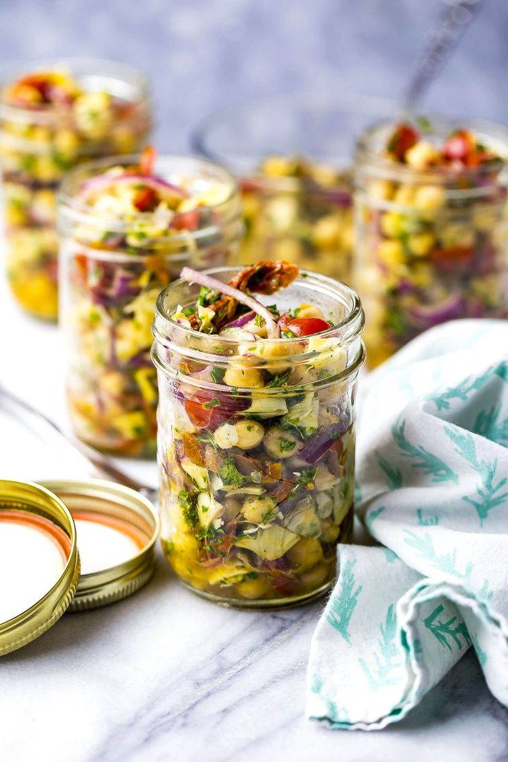 These Mediterranean Chickpea Salad Jars with artichokes & sundried tomatoes are the perfect packable lunch - they're also vegetarian and gluten-free!