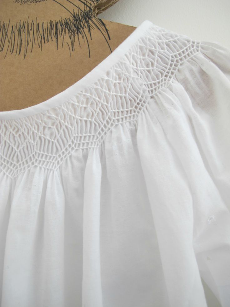 White smocked blouse                                                                                                                                                     Plus