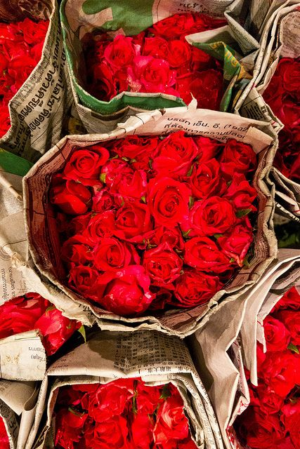 Some of the many varieties of flowers found at the wholesale flower market in Bangkok.  The market, known as Pak Klong Talat in Thai, is open around the clock and is busiest in the early hours of the morning when growers bring flowers, fruit, and vegetables into the city.    Each bundle of 50 roses costs about two dollars.