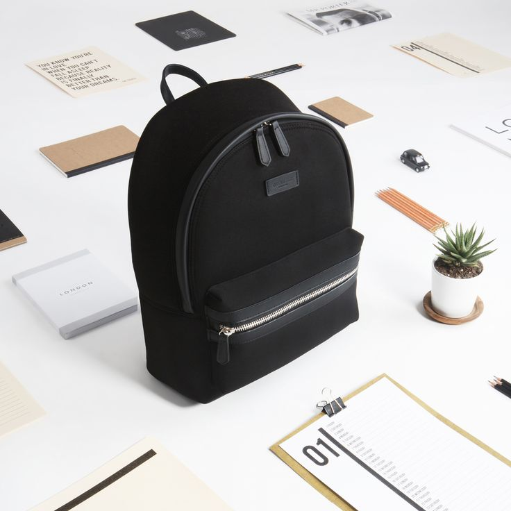 Black backpack crafted with neoprene and vegan leather.