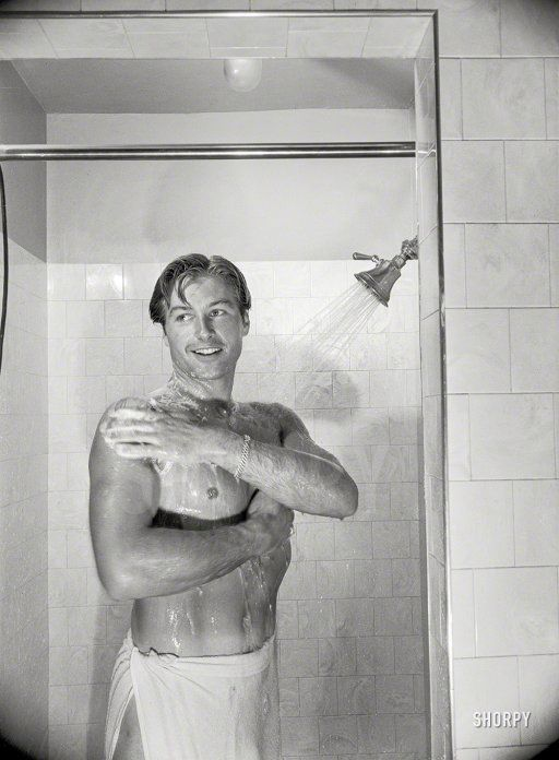 "Lex Barker, Los Angeles, 1948. ""Shower ends Lex's non-acting day that includes lifting weights, punching bag and many other exercises."" From photos by Maurice Terrell for the Look magazine assignment ""Lex Barker: Princeton-Bred Tarzan."""