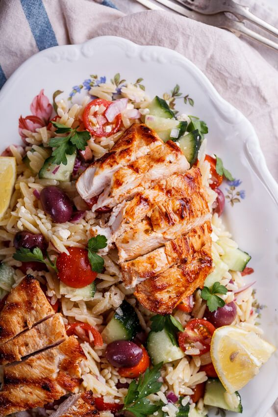Greek orzo salad with grilled chicken. Replace orzo with cauli-rice for a low carb dinner. Maybe add some garlic to the chicken marinade