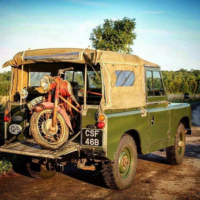 Land Rover and what looks to be a Royal Enfield stuffed in back.