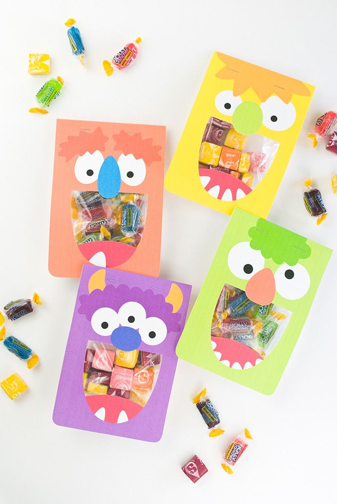 Silly Monster Treat Bags | Handmade Charlotte--BY MOLLIE JOHANSON These printable monster mouth treat bag toppers are the perfect way to hand out some sweet snacks! When assembled, the treats show through the cut out mouth so it looks like each monster is eating them, and there are four designs to choose from!