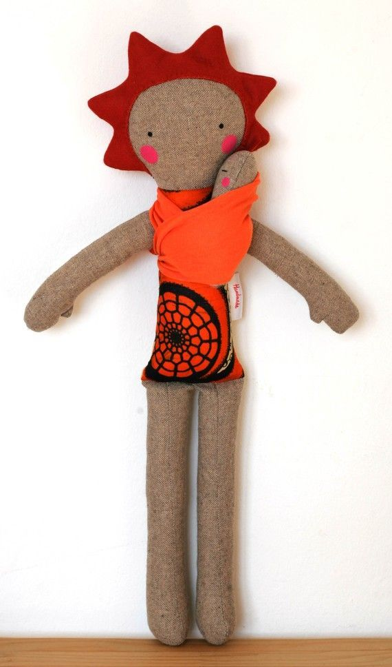 I love this babywearing doll, by Frida´s Tierchen. Simple, sweet, and fun!