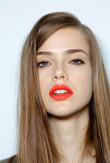 bright orange lips with warm brown/natural eye makeup. Much easier to wear than I expected!