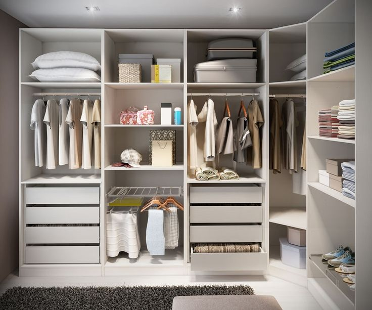 Contemporary Closet with Custom closet storage, Laminate floors, Shag area rug, Ikea Pax Corner Section Frame, White