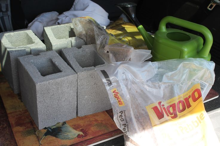 .98 cement blocks, 1 bag of pea pebbles and a solar patio light.  Dogs and kids can't knock them over and they look good too!  Take a look!
