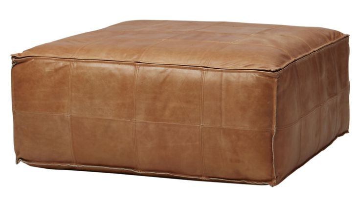 "cozy + rugged leather pouf as coffee table: CB2 leather ottoman-pouf (36"" x 36"") $549"