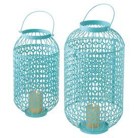 """Cast a flickering glow over your three-season porch or living room with these openwork metal candle lanterns, featuring latticed detailing and a mint hue for chic appeal.  Product: Small and large candle lantern Construction Material: Metal and glassColor: MintFeatures:  Latticed detailingOpenwork designAccommodates: (1) Candle each - not included Dimensions: 22"""" H x 12"""" Diameter (large)"""