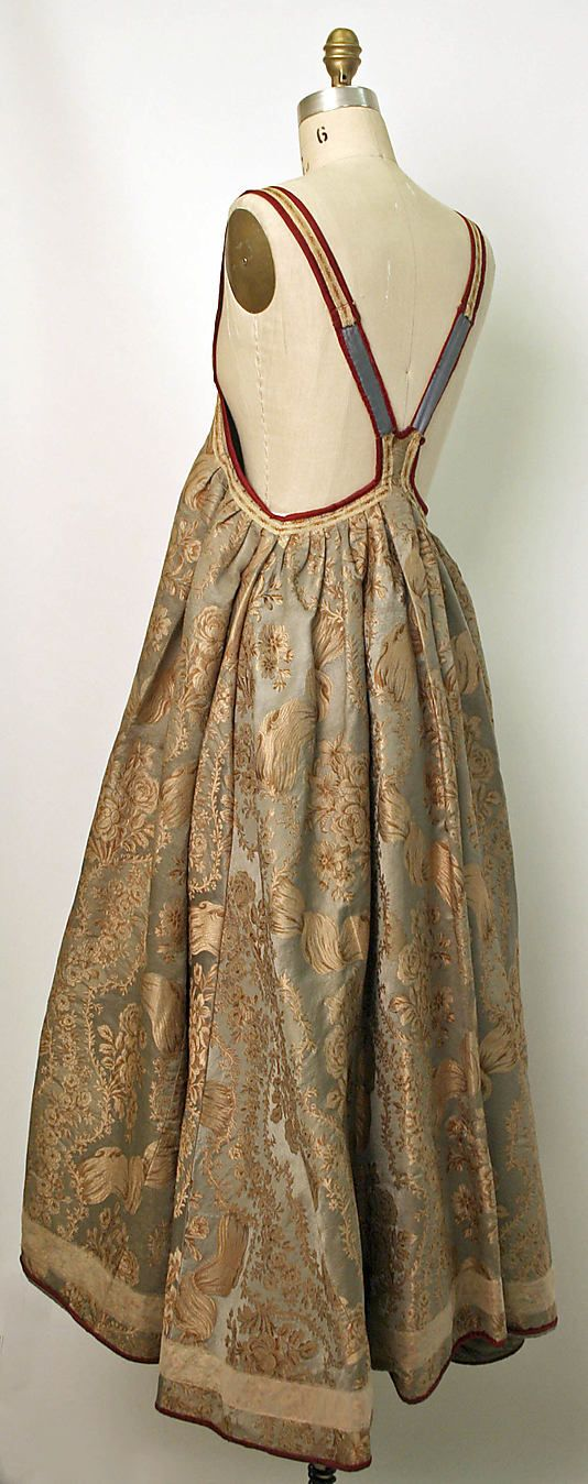 Russian sarafan   19th century Culture: Russian Medium: silk, cotton or linen Dimensions: (a) Length at CB: 41 in. (104.1 cm) (b) Length at CB: 17 1/2 in. (44.5 cm)
