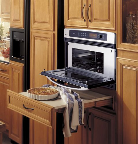 Surface below oven. Great for easily and conveniently transferring items out of the oven