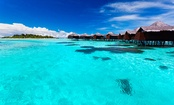 Matira Beach, Bora Bora, Tahiti  The famed island of Bora Bora is home to one of the world's most spectacular beaches. The white sandy beach sits on a lagoon protected from the ocean by a barrier reef. The temperature of the vibrant blue waters is usually around a pleasant 80° F.