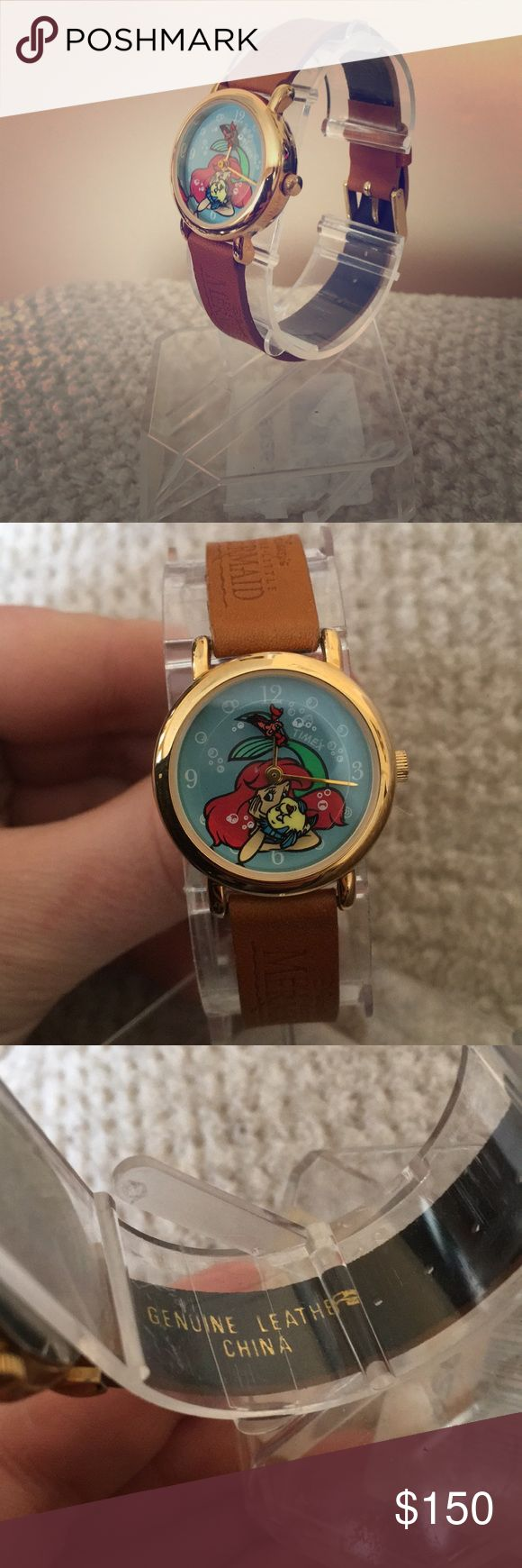Vintage 1990's Little Mermaid Watch Brand new on original store display.  Brown genuine leather strap.  Flounder and Sebastian move with time over Ariel.  Needs battery.  Timex brand.   WOW what a RARE and amazing find!! (Like on the store display from the 90's WHATTT?!? Lol)   Posh Ambassador Fast Shipping ⭐️5 Star Rated⭐️ THANK YOU❤️ Timex Accessories Watches